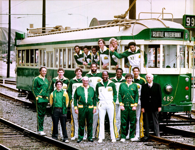 The 1979-1980 Sonics pose for a team photo at the Seattle Waterfront. Led by Gus Williams and a young Dennis Johnson, the reigning NBA champions charged to the Western Conference finals before they were derailed by a Lakers squad featuring rookie sensation Magic Johnson. The Sonics would not make it back to the conference finals until 1987.