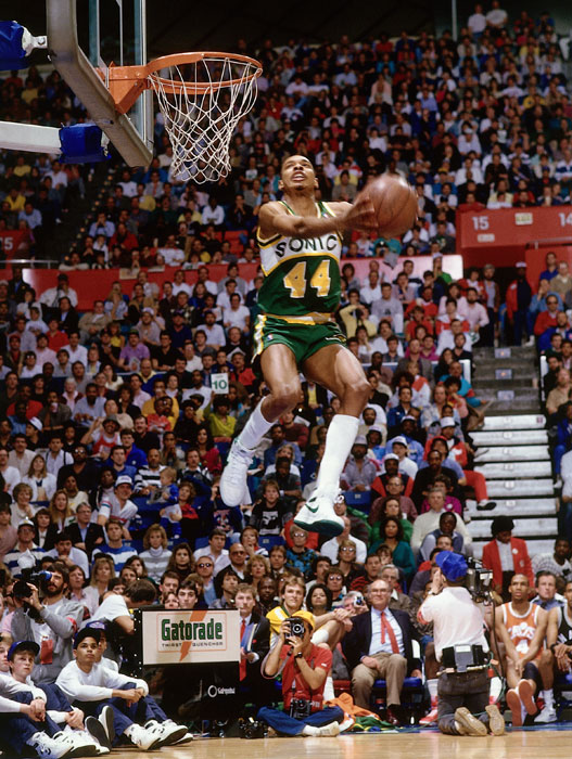 Terrence Stansbury pulls the ball back for a reverse jam during the 1987 NBA Slam Dunk contest at Key Arena in Seattle. Though he played only three seasons in the NBA, Stansbury competed in the Slam Dunk contest in each of those years. He finished third in all three contests, losing to accomplished dunkers Dominique Wilkins, Spud Webb and Michael Jordan.