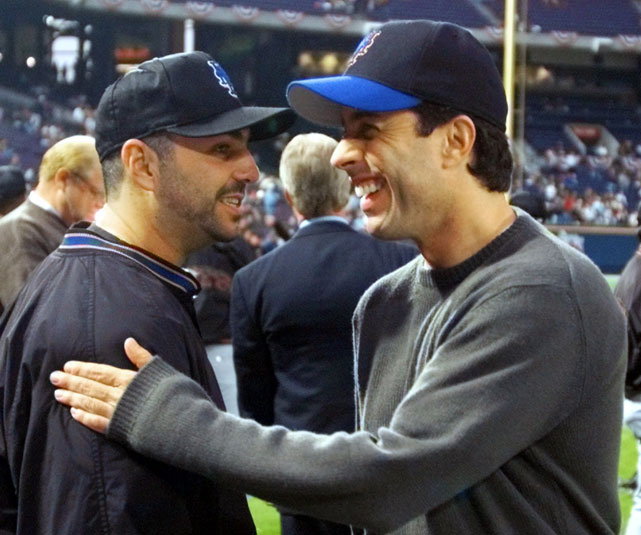 Jerry Seinfeld converses with  Mets pitcher John Franco before Game 6 of the 1999 National League Championship Series in Atlanta.