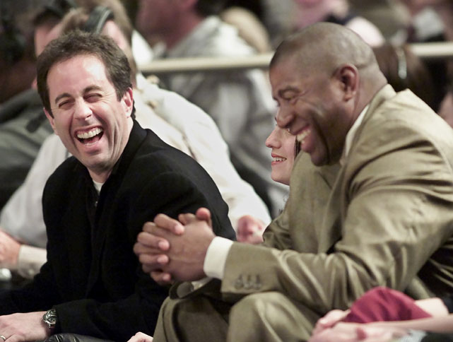 Seinfeld shares a laugh with Magic Johnson during a 2001 Heat-Knicks game at Madison Square Garden.
