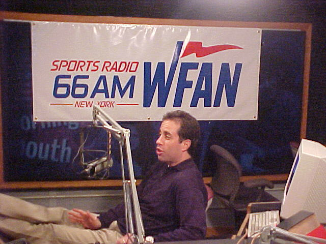 Longtime sports fan Jerry Seinfeld spends time in New York's WFAN studios.