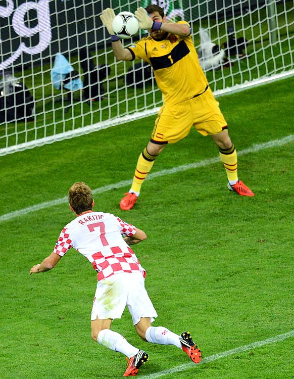 "Iker Casillas' save on Ivan Rakitic's header in the 59th minute preserved a scoreless duel that Spain later broke to win Group C and advance to the quarters.  Jesus Navas sealed a 1-0 win for Spain, but the defending World Cup champions put forth a lackadaisical performance that included several key chances from the Croats. Described as ""insipid"" and ""uninspired"" on the attack, coach Vicente del Bosque's side did not inspire the audience after a blowout win over Ireland. Spain still finishes atop Group C and will take on the runner-up in group D."