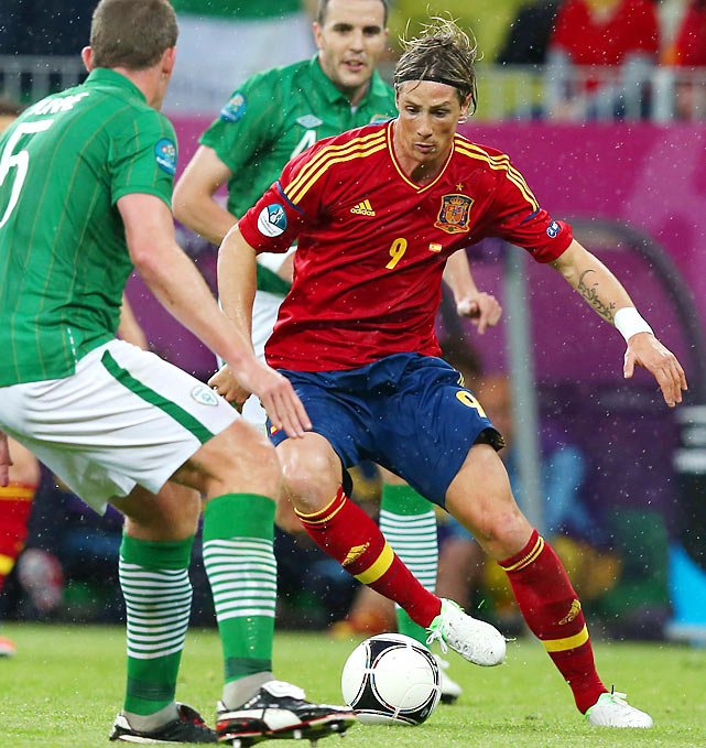 "Despite his recent struggles, Spain's Fernando Torres looked much like his former self, smashing home a goal in the fourth minute en route to an easy 4-0 win over Ireland. The match was completely lopsided, but the Irish fans still hung around to loudly sing ""The Fields of Athenry"" in the closing minutes of the match."
