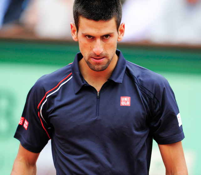 "In his first trip to the French Open final, Djokovic struggled to get momentum going as rain caused several delays in the action. After losing the first two sets to Nadal, the two were sent back to the locker room for a half hour break for the rain to clear. Djokovic began mounting a comeback when play resumed, but the rain picked up again and the final was pushed to a Monday finish. Nadal came out firing and Djokovic fell short complete the ""Novak Slam"" -- holding all four Grand Slam titles, a feat last accomplished by Rod Laver in 1969."
