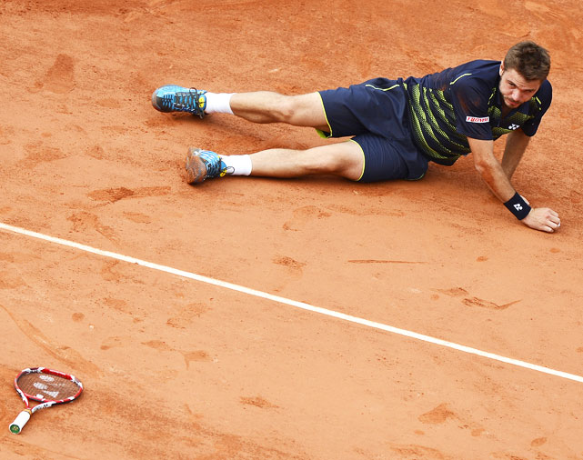 In a match that stretched over two days, Wawrinka lost to Jo-Wilfried Tsonga in the fourth round. After a wipeout on the red clay, Wawrinka tried to play a ball from the dirt, without his racket. It didn't work out well for him.