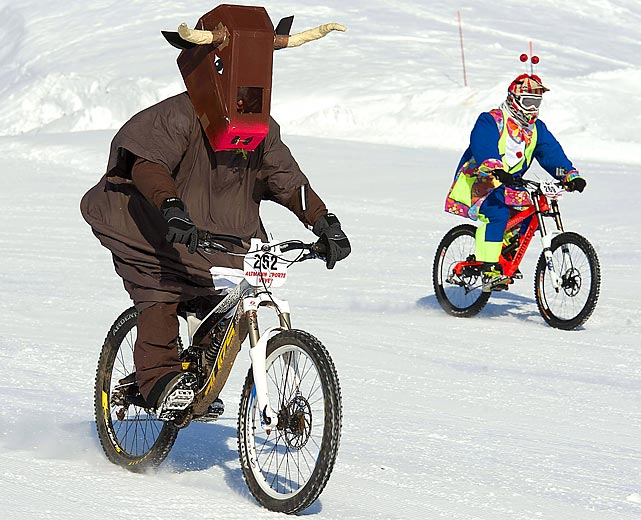 In case you're questioning your sanity, this is an actual mountain bike snow race in the alpine resort of Villars, Switzerland.