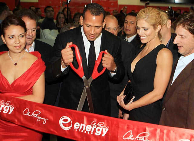 A-Rod appears to be performing some kind of self-surgery at the opening of a new Energy Fitness center in Mexico City.