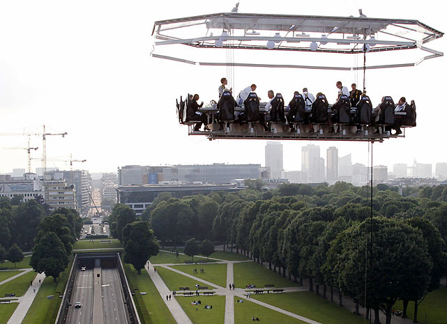 High priced cuisine: a mysterious UFO over Cinquantenaire Park in Brussels turned out to be a floating restaurant suspended 130 feet above the ground. Kinda hard to beat the check if you don't have a parachute...