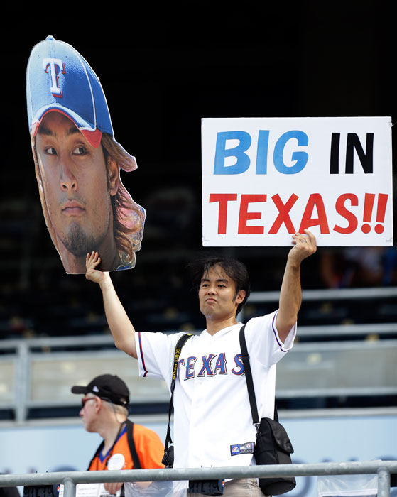 A fan holds a sign for Texas' Yu Darvish before the MLB All-Star Game.