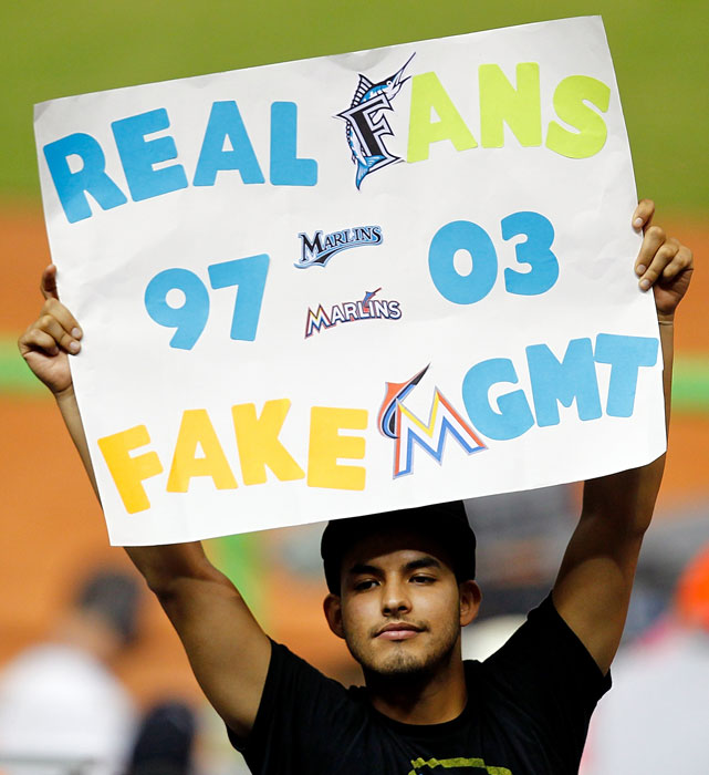 A disenchanted Marlins fan holds a sign after the team traded franchise star Hanley Ramirez to the Dodgers.