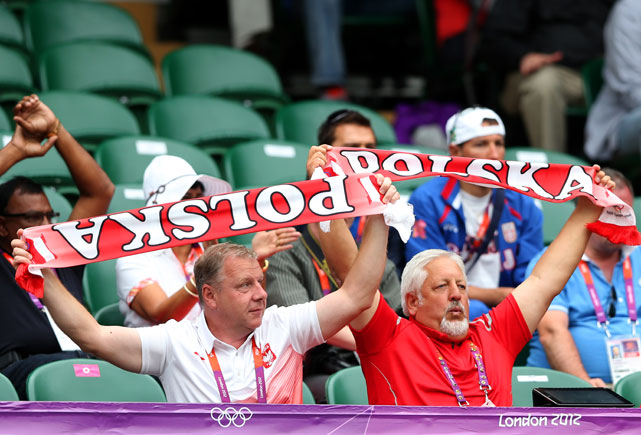 Poland fans hold scarves aloft as they enjoy the atmpshere during the Women's Singles Tennis match between Agnieszka Radwanska of Poland and Julia Goerges of Germany on Day 2 of the Olympics.