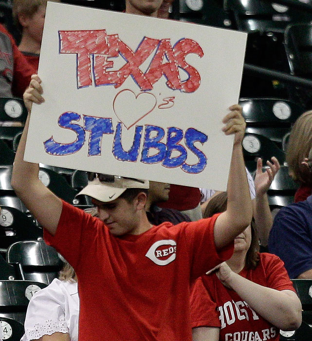 A Cincinnati fans cheers on Drew Stubbs during a Reds-Astros game in Houston.