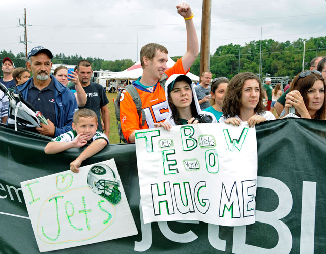 Jets fan wait to meet their newest hero, Tim Tebow, at the team's training camp in Cortland, N.Y.
