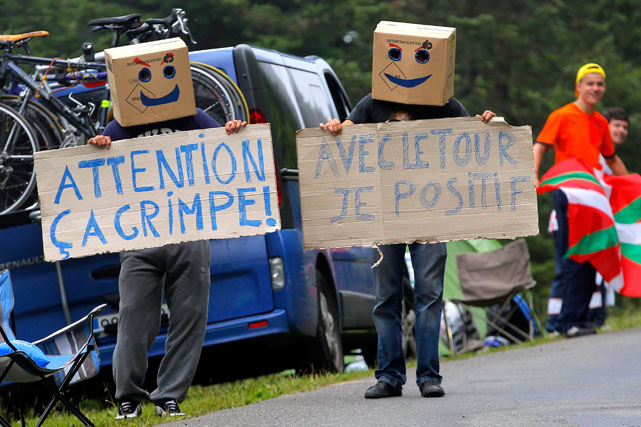 Fans display signs on the roadside during Stage 17 of the Tour de France.