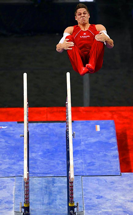 Sam Mikulak does a double back flip as he dismounts the parallel bars at the U.S. Olympic trials in San Jose, Calif.  Mikulak was the final man added to the deep American gymnastics team for London.
