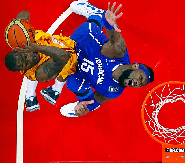 Macedonia's Lester McCalebb (left) goes up strong against the Domincan Republic's Jack Martinez during the 2012 FIBA Olympic qualifying basketball tournament in Caracas, Venezuela, on July 6.
