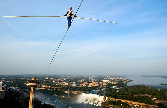 Tightrope-walker Jay Cochrane balances along a wire from the Skylon Tower to the Hilton over the city of Niagara Fall, Ontario, on July 6.  The wire stretches 1,300 feet, and is 581 feet from the ground at its highest point.