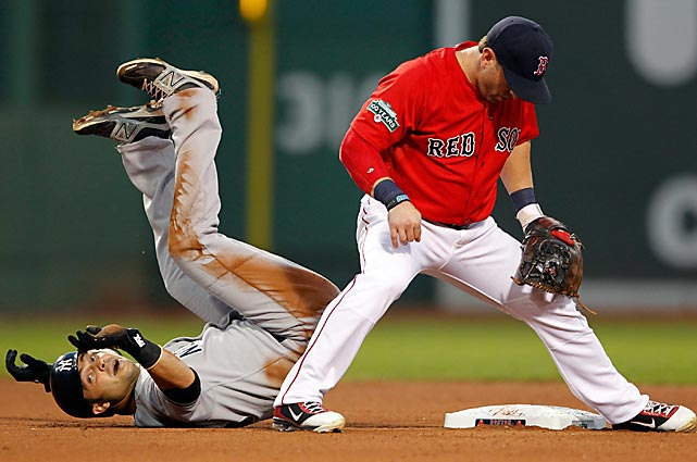 Red Sox second baseman Nick Punto tags out the tumbling Nick Swisher of the Yankees in the second game of their doubleheader on July 7.  The Red Sox would take the game 9-5, but the Yankees won three of four in the series to enter the All-Star break with the best record in baseball.