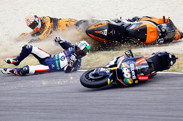 Kalex Moto2 rider Pol Espargaro (front) of Spain collides with Motobi Moto2 rider Johann Zarco of France during the third practice session for the Italian motorcycling Grand Prix. Recent criticism of the Mugello circuit cites the track as too narrow, allowing for accidents too easily.