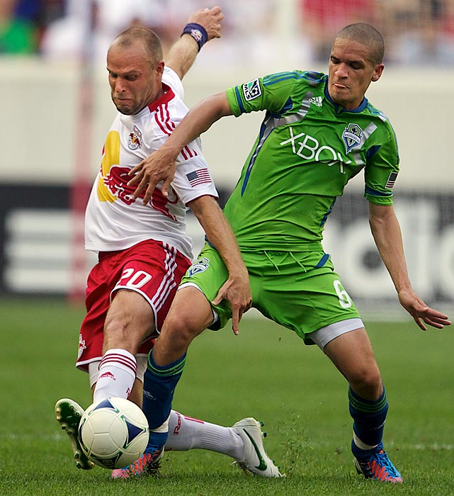 Joel Lindpere (20) of the New York Red Bulls fights for the ball with Osvaldo Alonso (6) of the Seattle Sounders at the Red Bull Arena on July 15. The game ended in a 2-2 tie, leaving the Red Bulls unbeaten at home with a 5-0-3 record.