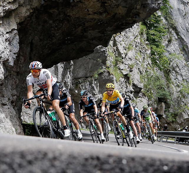 British cyclist Bradley Wiggins, wearing the yellow jersey, trails Edvald Boasson Hagen of Norway, left, as they race through the Granier pass during the 12th stage of the Tour de France.  The 140.5 mile journey started in Saint-Jean-de-Maurienne and finished in Annonay, France.