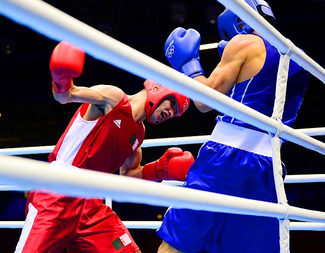 Abdelkader Chadi of Algeria battles against Turkey's Fatih Keles during a lightweight round of 32 bout on Sunday. Keles easily defeated Chadi 15-8, advancing to Round of 16 on Aug. 2.