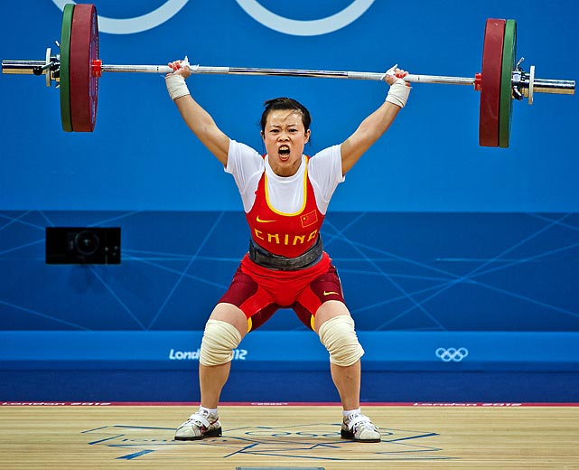 Mingiuan Wang of China heaves a massive 205kg total on Saturday night during the 48kg weightlifting competition to take home the gold.