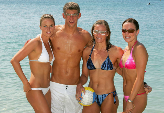 Olympians (from left) Amanda Beard, Michael Phelps, Jenny Thompson and Natalie Coughlin pose on the Athens beach during the 2004 Olympics.