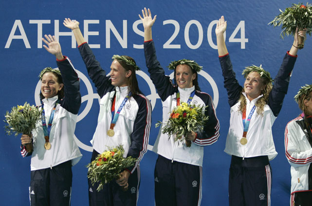 Team USA's 4x200m relay teammates (from left) Natalie Coughlin, Dana Vollmer, Carly Piper and Kaitlin Sandeno celebrate with their gold medals after setting a world record in the event at the 2004 Olympics.