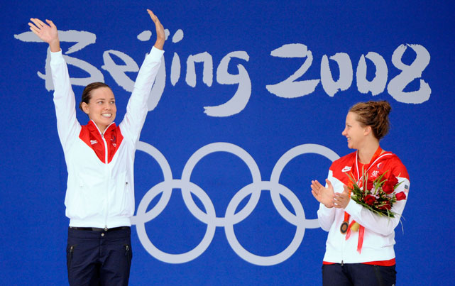 Coughlin (left) and teammate bronze medalist Margaret Hoelzer celebrate during the medal ceremony for the 100m backstroke final during the Beijing Olympics.