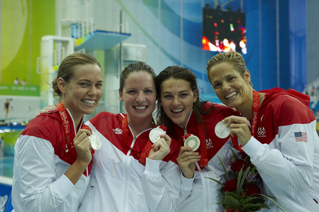 Coughlin (far left) and teammates Kara-Lynn Joyce, Lacey Nymeyer and Dara Torres flash their medals after taking second in the 4x100m freestyle relay at the Beijing Olympics.