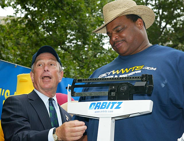 New York City Mayor Michael Bloomberg checks the weight of South Carolina hot dog eating champion and former Chicago Bears defensive tackle William (The Refrigerator)Perry at an official weigh-in ceremony for the 88th annual Nathan's Famous hot dog eating contest in New York.