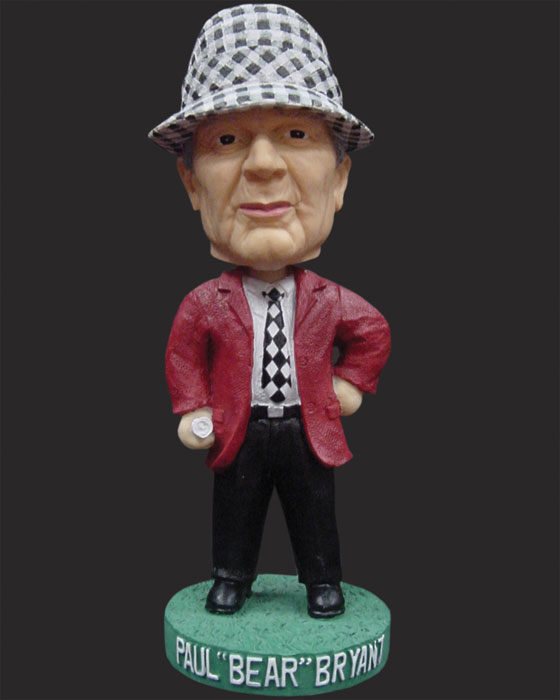 Legendary Alabama coach Bear Bryant is well represented in bobblehead form with his trademark houndstooth hat, crimson-colored jacket and a depth chart rolled up in his right hand.