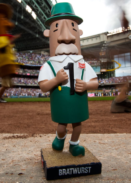 A bratwurst bobblehead doll is seen during the sausage race of a 2009 game between the Brewers and Cubs.