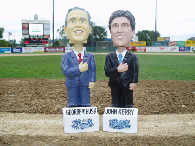 The bobbleheads of President George W. Bush and Senator John Kerry are on display at a 2004 minor league baseball game.