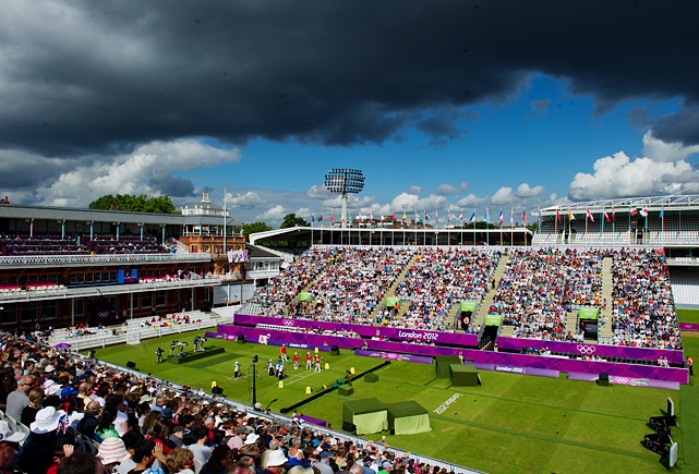 SI's best shots from Day 2 of the Olympic Games, beginning with the archery eliminations match between China and Italy.