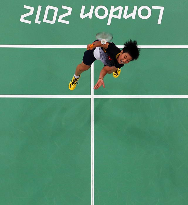 Wang Yihan of China extends for the shuttle against Michele Li of Canada in the Women's Badminton Singles.  Yihan won the match 21-8, 21-16.