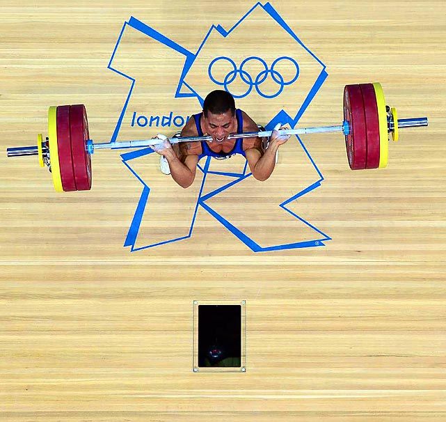 Micronesia's Manuel Minginfel begins to hoist the bar above his head in the men's 62kg