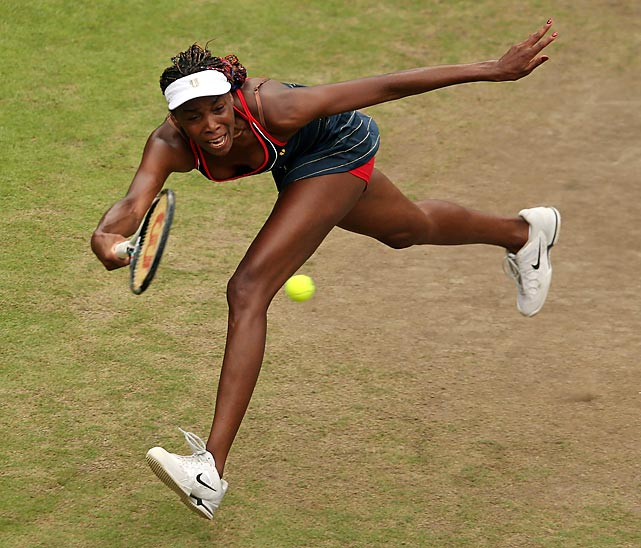 Venus Williams dives for a shot against Canada's Aleksandra Wozniak during the second round at Wimbledon. Williams won in straight sets.