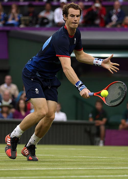Great Britain's Andy Murray backhands to return the ball to opponent Jarkko Nieminen of Finland during Murray's 6-2, 6-4 victory in the second round.