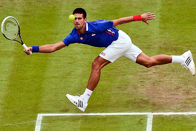 Novak Djokovic returns the ball to Andy Roddick during the second round of their match during the London Olympic Games at Wimbledon. Djokovic won easily, 6-2, 6-1.