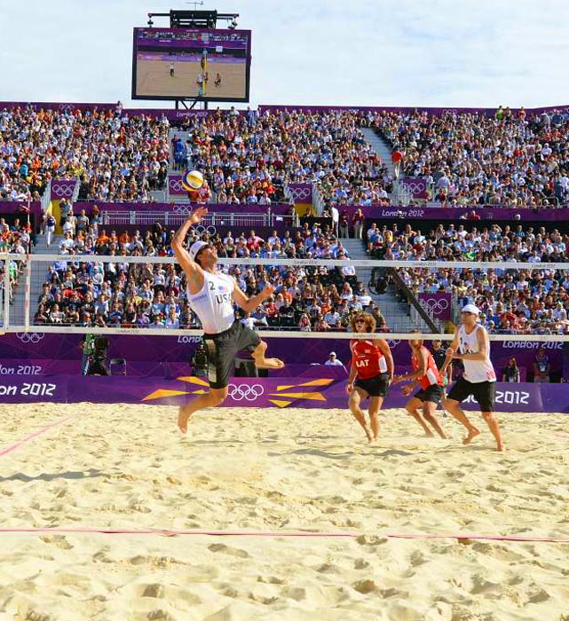 In a men's preliminary round beach volleyball match held on the imported Surrey sands of Horse Guards Parade, Sean Rosenthal went up as he and U.S. partner Jacob Gibb owned Latvia 2-0.