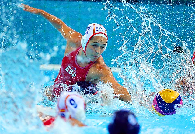 Laura Lopez Ventosa  of Spain braved the clash and splash to dig for the ball during a preliminary round water polo match against the U.S., as the two teams played to a 9-9 draw.
