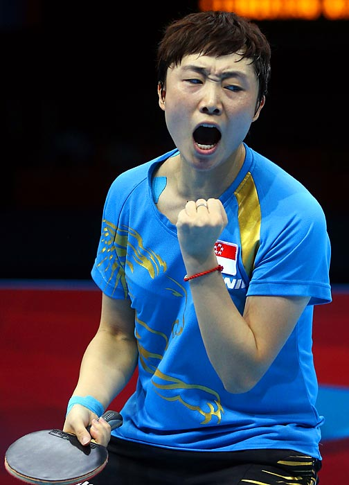 Tianwei Feng of Singapore celebrated during her match against Kasumi Ishikawa of Japan for the bronze medal in women's Singles Table Tennis. After losing 4-2 to Ning Ding of China in the semifinals, Tianwei Feng won the bronze medal match 4-0.