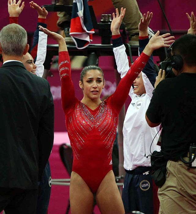 Overwhelmed with emotion, team captain Aly Raisman rejoices with her team after it claimed the all-around gold medal, besting Russia and China, the 2008 all-around team champions.