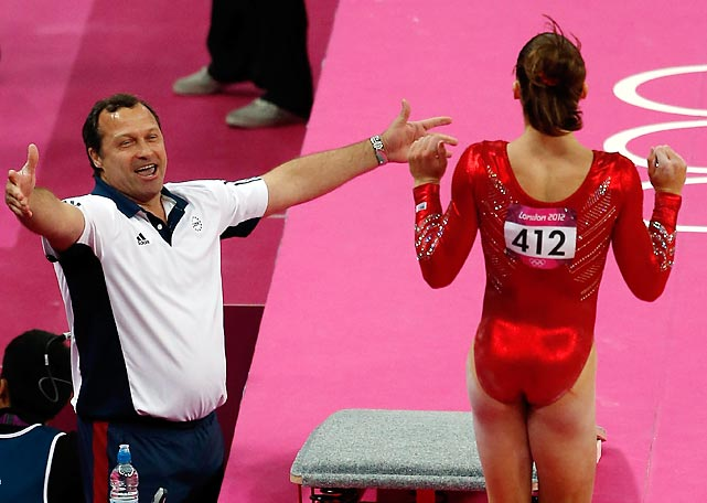 McKayla Maroney's coach, Arthur Akopyan, congratulates her after her nearly flawless vault. Maroney, the world champion in vault, competed in only her signature event for the team.