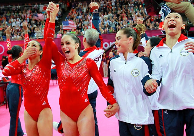 Team members ( from left) Aly Raisman, Jordyn Wieber, McKayla Maroney and Kyla Ross react to seeing Raisman's final floor routine score, making Team USA's first place victory official.