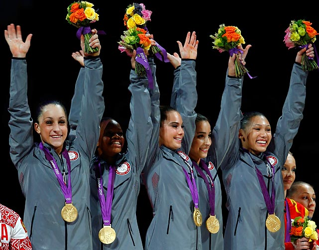 Untouchable gold medalists (from left) Jordyn Wieber, Gabby Douglas, McKayla Maroney, Aly Raisman and Kyla Ross celebrate while crowds cheer during the medal ceremony.