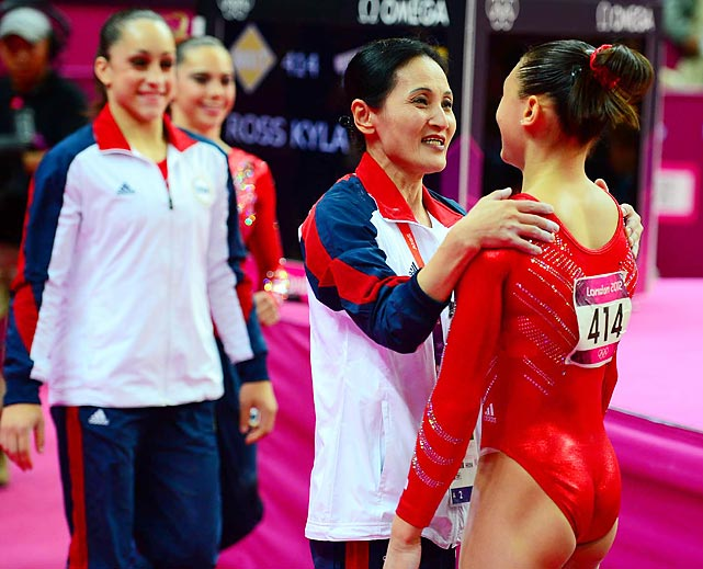 Kyla Ross, the youngest member of the team, celebrates with her coach, Jenny Zhang, after her performance.