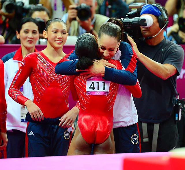 Reigning all-around World Champion Jordyn Wieber congratulates teammate Gabby Douglas after the gold medal announcement.